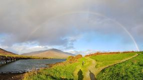 Irish rainbow. This beautiful rainbow shows it& x27;s gorgeous colors over the old railway bridge in Caherciveen town, Co. Kerry, Ireland, with a scenic Royalty Free Stock Photos