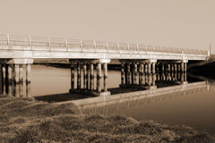 Irish road bridge over cold river in sepia Royalty Free Stock Images