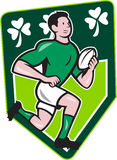 Irish Rugby Player Running Ball Shield Cartoon. Illustration of an Irish rugby player running with the ball set isnide shield with Ireland shamrock clover leaf Stock Photos