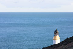 Irish Sea and lighthouse Douglas Isle of Man. Irish Sea, cliffs and lighthouse Douglas Bay Isle of Man British Isles Stock Photo