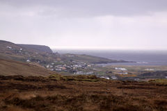 Irish seaside. Seaside settlement in Ireland with grey clouds royalty free stock images