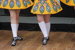 Irish Step Dancing Pose. Irish step dancing girls lined up to begin performance Royalty Free Stock Images