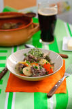 Irish stew. Traditional Irish stew served with bread, butter and Guinness beer Royalty Free Stock Image