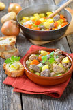 Irish stew. Homemade and slow cooked Irish stew with lamb, potatoes and other vegetables, served in a ceramic bowl Stock Photo
