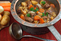 Irish stew in old copper pot Royalty Free Stock Photography