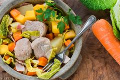 Irish stew with pork and vegetables cooked in cider - top view stock photos
