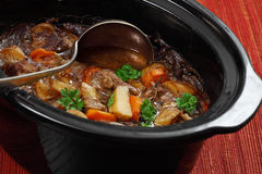 Irish stew in a slow cooker pot. Photo of Irish Stew or Guinness Stew made in a crockpot or slow cooker Royalty Free Stock Images
