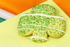 Irish sugar cookie on green plate Stock Photos