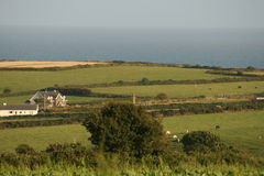 Irish summer scenery. All vegetation are growing up, typical panorama of irish village by the sea Royalty Free Stock Photography
