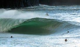 Irish Surfing. Heavy Irish wave breaking while surfers watch Stock Photos