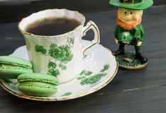 Irish tea with leprechaun. Display of Irish tea and green macarons with leprechaun Stock Photography