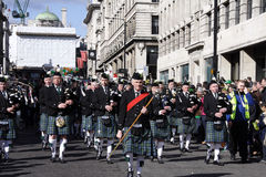 Irish veteran leading band in patrick day london. A veteran old man leading the musicians band on st patrick's day parade in London Royalty Free Stock Photography
