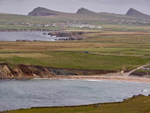 The Irish West coast on a windy day. The Irish West coast near Clogher, Dingle, on a stormy and cloudy day. The Three Sisters can be seen in the background Royalty Free Stock Photography