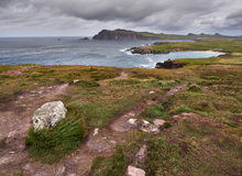 The Irish West coast on a windy day. The Irish West coast near Clogher, Dingle, on a stormy and cloudy day. The Three Sisters can be seen in the background stock photo