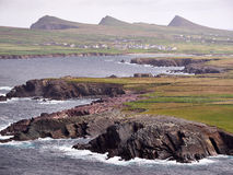 The Irish West coast on a windy day. The Irish West coast near Clogher, Dingle, on a stormy and cloudy day. The Three Sisters can be seen in the background stock photos