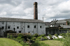Irish Whiskey Distillery. A view of a whiskey distillery taken from across the main road. This traditional travel scene in Ireland was seen on a cloudy day stock images