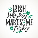 Irish Whiskey Makes Me Frisky. Funny handdrawn dry brush style lettering, 17 March St. Patrick`s Day celebration. Suitable for t-shirt, poster, etc Stock Image