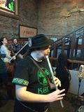 Irish whistle player performs at Corvallis bar on Saint Patrick's day, 2016 Royalty Free Stock Photos