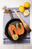 Irish wild salmon steak in a cast iron pan Stock Photo