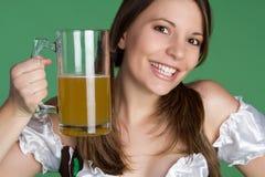 Irish Woman. Happy irish woman holding beer Royalty Free Stock Photography