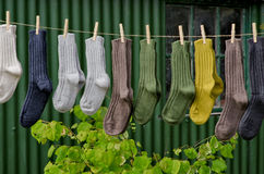 Irish wool winter knit socks. Irish wool chunky knit ribbed winter socks on a line in outdoor setting Stock Photos