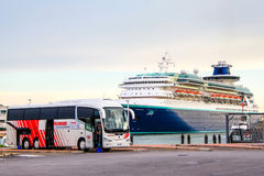 Irizar i6 near the cruise ship Stock Image
