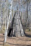 Irkutsk region,RU-May,10 2015: Pole chum - portable dwelling in a conical shape, covered with bark. Museum of Wooden Royalty Free Stock Photo