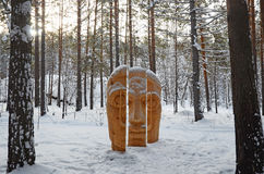 Irkutsk Region,Russia-Jan, 03 2015: Face of three parts. Park of wooden sculptures in Savvateevka Village Stock Photo