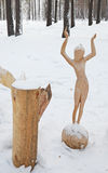 Irkutsk Region,Russia-Jan, 03 2015: Girl on the Ball. Park of wooden sculptures in Savvateevka Village Royalty Free Stock Photos