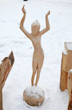 Irkutsk Region,Russia-Jan, 03 2015: Girl on the Ball. Park of wooden sculptures in Savvateevka Village Royalty Free Stock Image