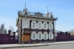 Irkutsk, Rosja, Marzec, 16, 2017 ` Koronkowego ` drewniany dom handlowy Shastin w Irkutsk Ulica Friedrich Engels, dom, 21 Obraz Stock