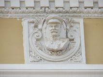 Accidentally preserved bas-relief of Stalin on the facade of the old building of the East-Siberian Railway Administration royalty free stock photos