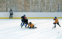 Irkutsk, Russia - Dec, 09 2012: The hockey tournament between teens teams in honor of the opening of the new rink Stock Image