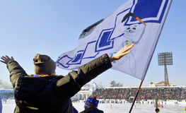 Irkutsk, Russia - Feb, 26 2012: Jubilant fans and a flag in the stands during the bandy match Stock Images