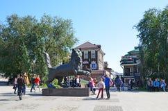 Irkutsk, Russia, August, 29, 2017. People walking near Babr - the symbol of the city of Irkutsk in summer. Irkutsk, Russia. People walking near Babr - the symbol stock photos