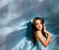 Irl in the blue dress from flying fabric Royalty Free Stock Photography