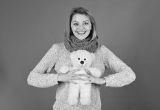 Irl with happy face plays with white soft toy. Pretty toy concept. Lady with blond hair cuddles with bear. Irl with happy face plays with white soft toy. Pretty royalty free stock photos