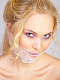 Irl with lace mask on the mouth. Sensual girl with lace mask on the mouth royalty free stock images