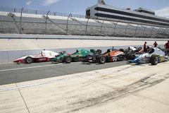 IRL Open Wheel Racing Cars On Pit Row Royalty Free Stock Photo
