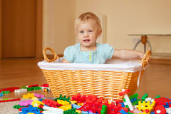 Irl plays with toy blocks Stock Photography