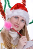 Irl in  santa hat Writing Royalty Free Stock Photo