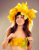 Irl with a wreath of autumn leaves Royalty Free Stock Photo