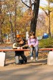 Irmão e irmã no parque Imagens de Stock