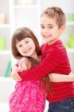 Irmão mais novo e irmã Fotografia de Stock Royalty Free