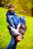 Irmãos em Autumn Park Imagens de Stock Royalty Free