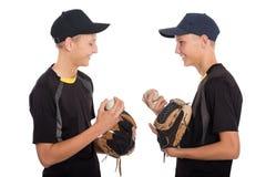 Irmãos gêmeos bonitos - jogadores de beisebol novos Fotografia de Stock Royalty Free