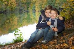 Irmãos novos na floresta do outono Fotos de Stock Royalty Free