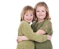 Irmãs no fundo branco Foto de Stock