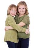 Irmãs no fundo branco Fotos de Stock Royalty Free