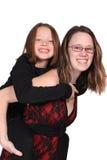 Irmãs ou uma baby-sitter Fotografia de Stock